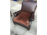 Large brown leather armchair , great shape and super comfy. On castor wheels. Free local delivery.