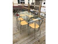 Glass kitchen table and 6 chairs