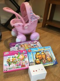 Younger girls toy bundle - including pram, 3 jigsaw puzzles and a pairs game.