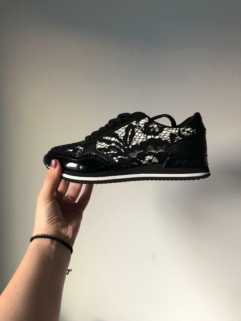 c815b2f61e96 DKNY laced trainers