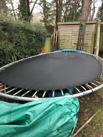 15ft oval trampoline with safety net.