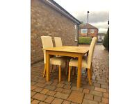 Marks and Spencer extendable dining table and four chairs