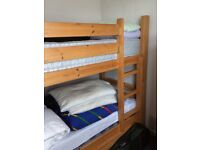 Bunk bed with mattresses. In good condition.