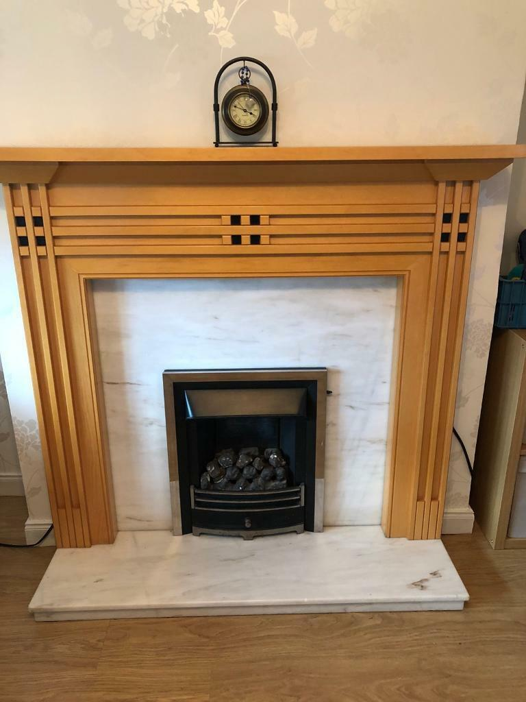 Beech fireplace and marble back n hearth.NO FIRE