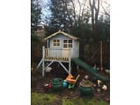 Wooden playhouse with chute in good condition