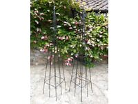 A PAIR BLACK DECORATIVE METAL GARDEN OBELISKS CLIMBING PLANT SUPPORTS IDEAL FOR ROSES & CLEMATIS