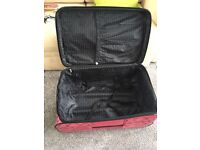 Large pink suitcase for sale