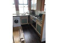 9 Unit Kitchen vinyl cabinet & doors, worktop, sink, integrated fridge freezer, Baumatic hob & oven