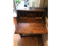 A good antique writing desk. Requires a good varnish and a little tlc.