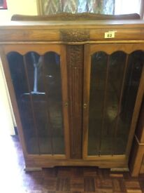 Vintage solid wood cabinet with floral carvings