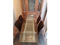 Extending glass table with 4 brown faux leather chaira