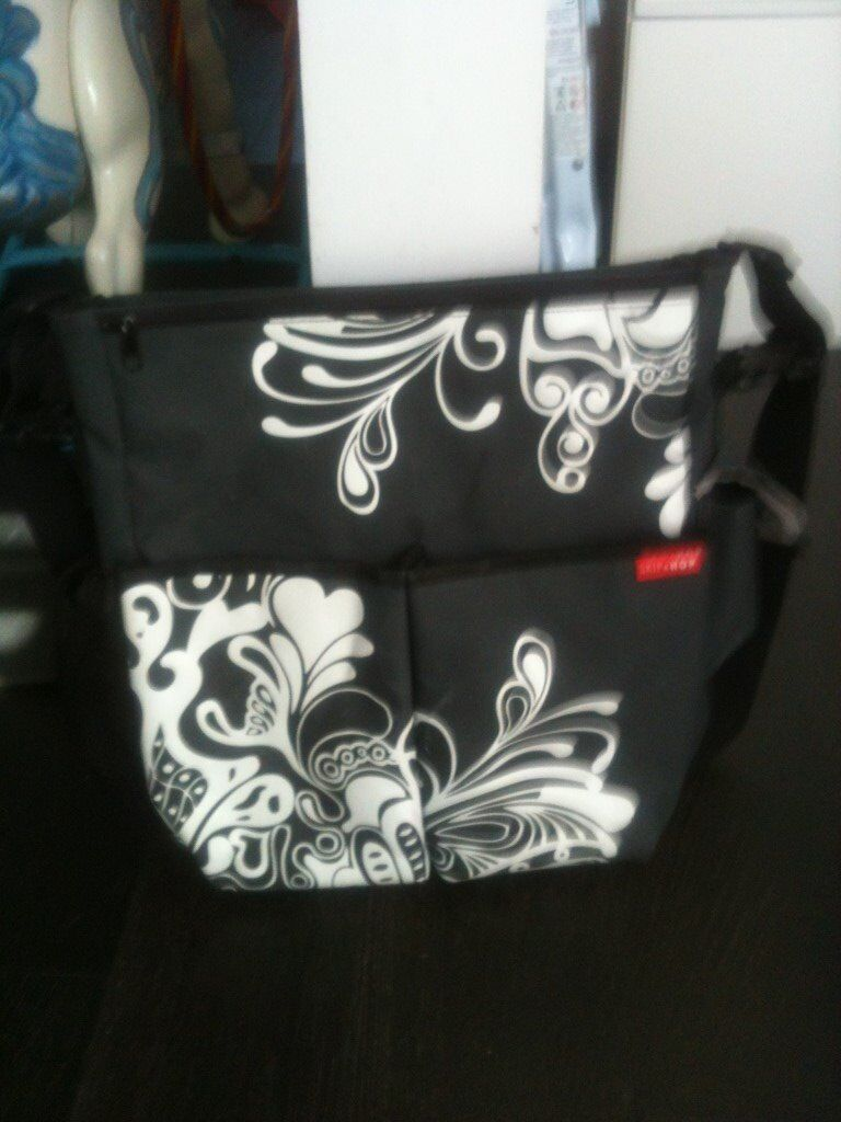 Skip Hop changing bagRRP60in Kingston, LondonGumtree - Skip Hop change bag Two zip pockets either side of bag unisex design On the front are two deep pockets On the back is a big, wide pocket which holds the changing mat changing mat included long shoulder strap which can be adjusted in length Buggy...