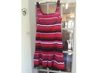 Oasis contemporary, black, white,pink, red stripped dress. Size 12.