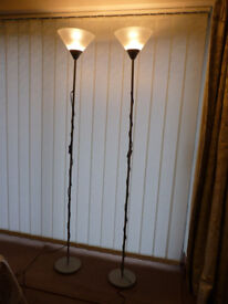 Pair of floor-standing up-lighters, 1.75m high (adjustable) metal finish, white translucent shades.
