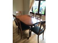 Dining table, six chairs and matching sideboard.