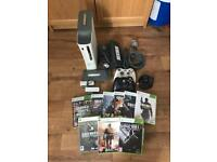 Xbox 360 console with two controller and games