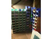 Wall mounted steel panel racking with plastic bins