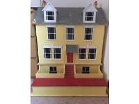 Large wooden dolls house.
