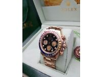 Rose Gold Rolex Daytona Rainbow blac face with time stones with rose Gold bracelet All boxed bagged