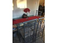 Silver glass table and 4 chairs.