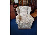 Patterned fabric wing back armchair