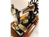 Antique hand cranked singer sewing machine
