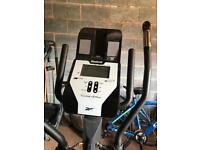 Reebok cross trainer with docking station and built in speakers