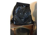 Unused black faux leather wolfs head laptop rucksack