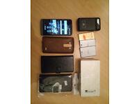 LG G3 32GB Unlocked smart phone,glass screen protector,4 batteries,3 cases & 1 external batt charger