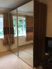 Huge Mirror-Froted Wardrobe. Elegant walnut sides. Lots of storage. Going cheap for house move!