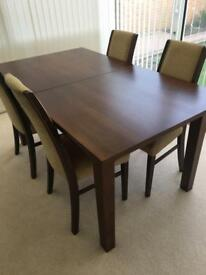 Extending solid oak table and 6 dining chairs