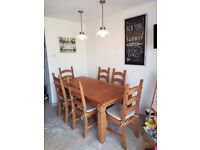 Rustic Oak dining table and six chairs