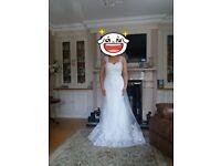 Brand new ivory wedding dress size 10 never wore