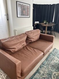 Two-seat brown faux-leather sofa