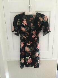 Black floral wrap dress. Size 8