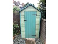 Shed with shelving and window - great condition