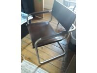 Stylish leather? Chair . Metal frame, very strong and very comfortable.