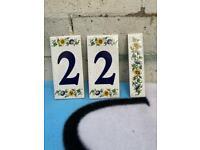 Tile house number 22