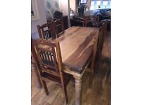 Solid wooden Mexican dining table with 6 chairs.
