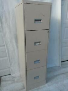 Large 4 drawer steel legal size grey file cabinet. size  Wide 18 ,  Deep  27, 52  High