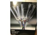 Champagne flutes in glass ice bucket