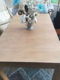 Mid / light oak extendable table plus 6 chairs