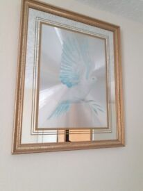 Picture with a bird in glass