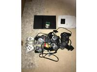 PS1 and PS2 consoles with 4 controllers + 2 memory cards