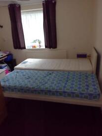 Single bed with additional bed underneath to make double bed