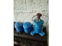 Camping stove with spare canisters