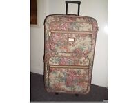 """Tapestry suitcase on wheels 30"""" x 17"""" with outside zip compartments. Excellent condition."""