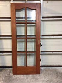 Hardwood glass panel door