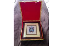 Beautiful hand stitched on silk Chinese warrior face in bordered frame and silk box