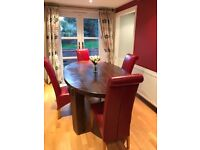 Oval solid oak table with 4 red leather chairs